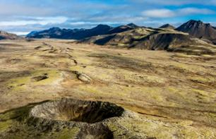 Helicopter flight over volcanic craters
