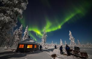 Sledge ride pulled by a snowmobile under the Aurora Borealis & barbeque around a camp fire - Rovaniemi - Lapland