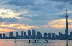 Yoga Class on a Stand-Up Paddle Board at Sunset